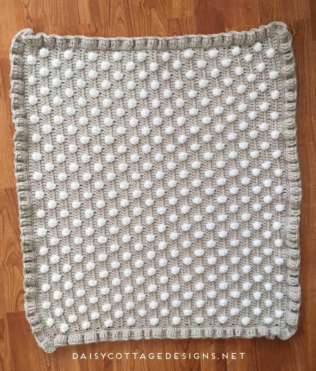 free crochet pattern | crochet blanket pattern | crochet baby blanket | polkadot blanket | Daisy Cottage Designs | Use this free crochet baby blanket pattern to make an adorable baby shower gift. Or, make a larger size and throw it over your couch, chair, or bed. It's a beautiful pattern with detailed instructions and a video tutorial.