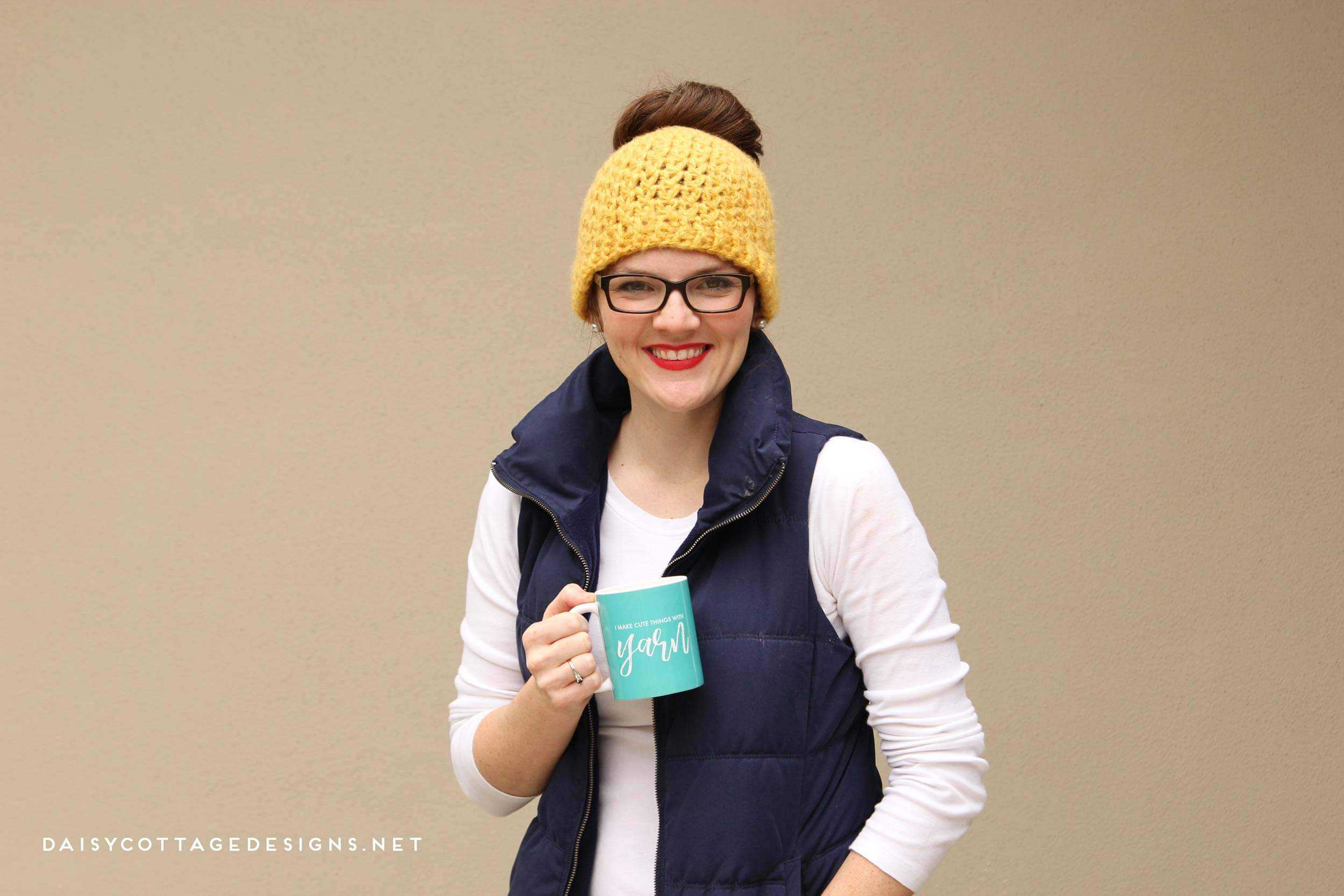 Use this messy bun crochet pattern from Daisy Cottage Designs to make the perfect cold weather hat. | messy bun hat, free crochet pattern, ponytail hat