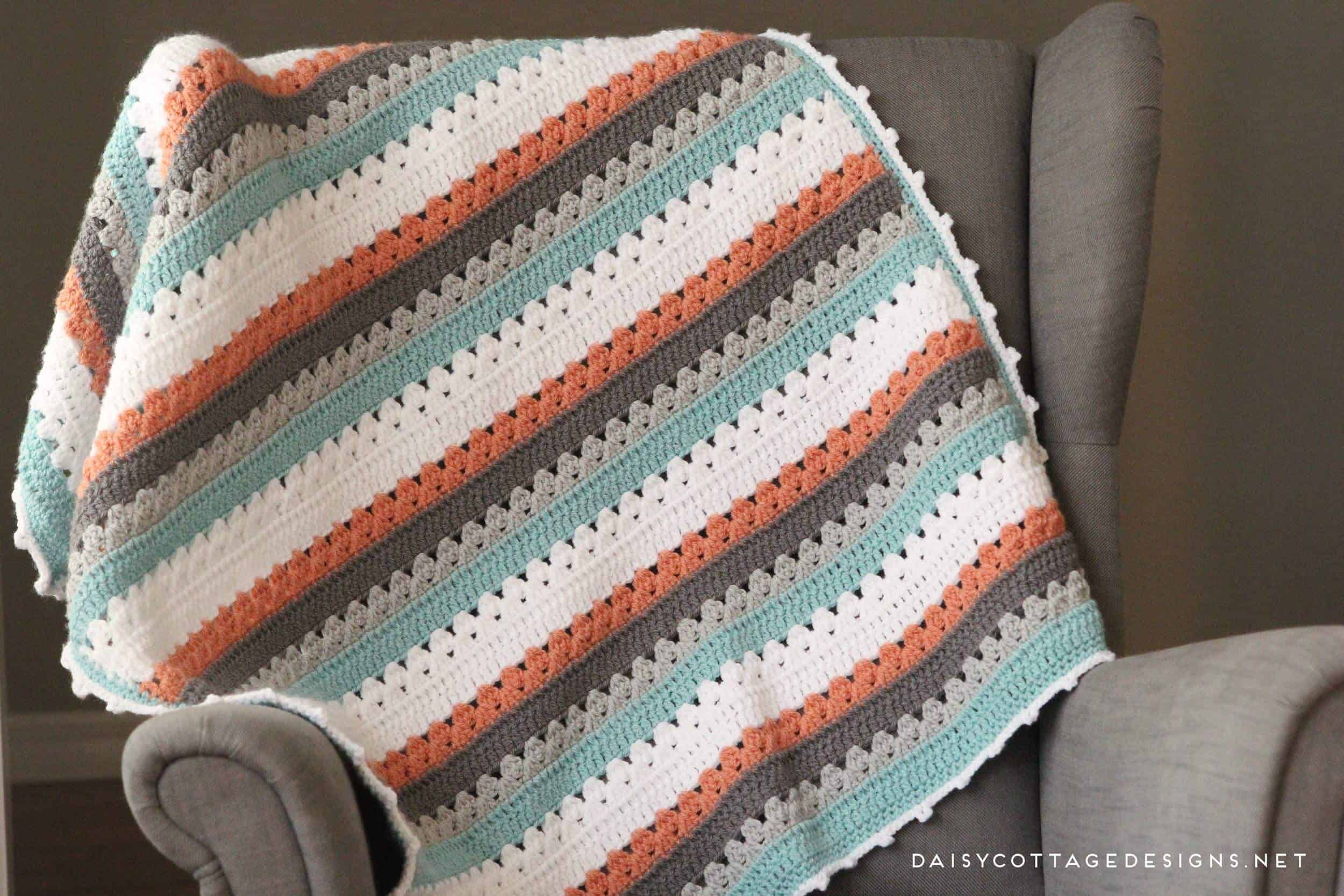 Use this blanket crochet pattern from Daisy Cottage Designs to create a beautiful afghan in any color way. | free crochet pattern, easy crochet pattern, free blanket crochet pattern, granny stripe crochet pattern