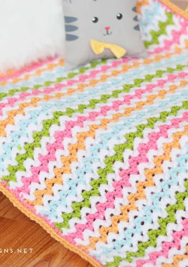 Enjoy this v-stitch crochet pattern from Daisy Cottage Designs. Use this free crochet pattern to make an afghan in any size.