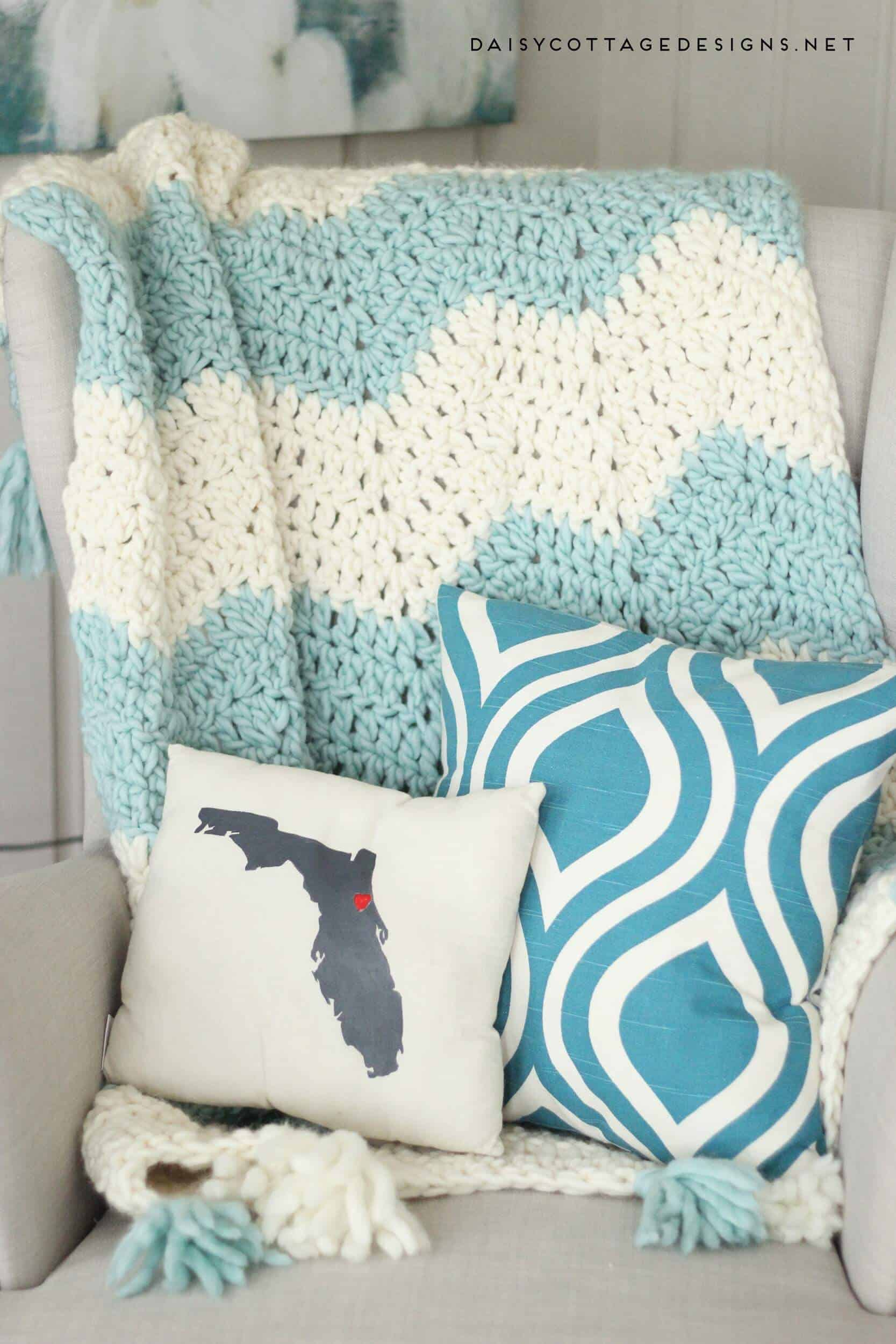 Chunky Chevron Crochet Blanket with Tassels. Beautiful and easy to make. Get a discount on this beautiful Yarn, too! | chunky chevron blanket, quick crochet blanket, bulky yarn patterns, Daisy Cottage Designs