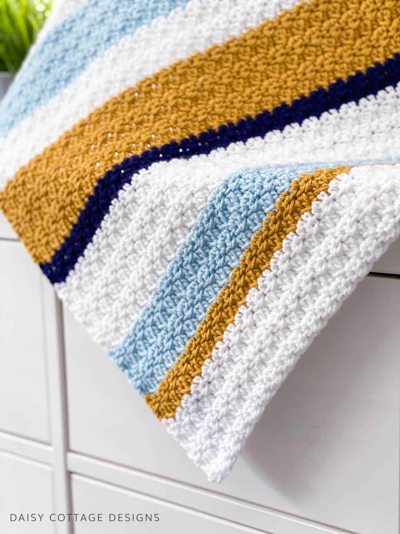 Use this Modern Crochet Blanket Pattern from Daisy Cottage Designs to create your next beautiful blanket.