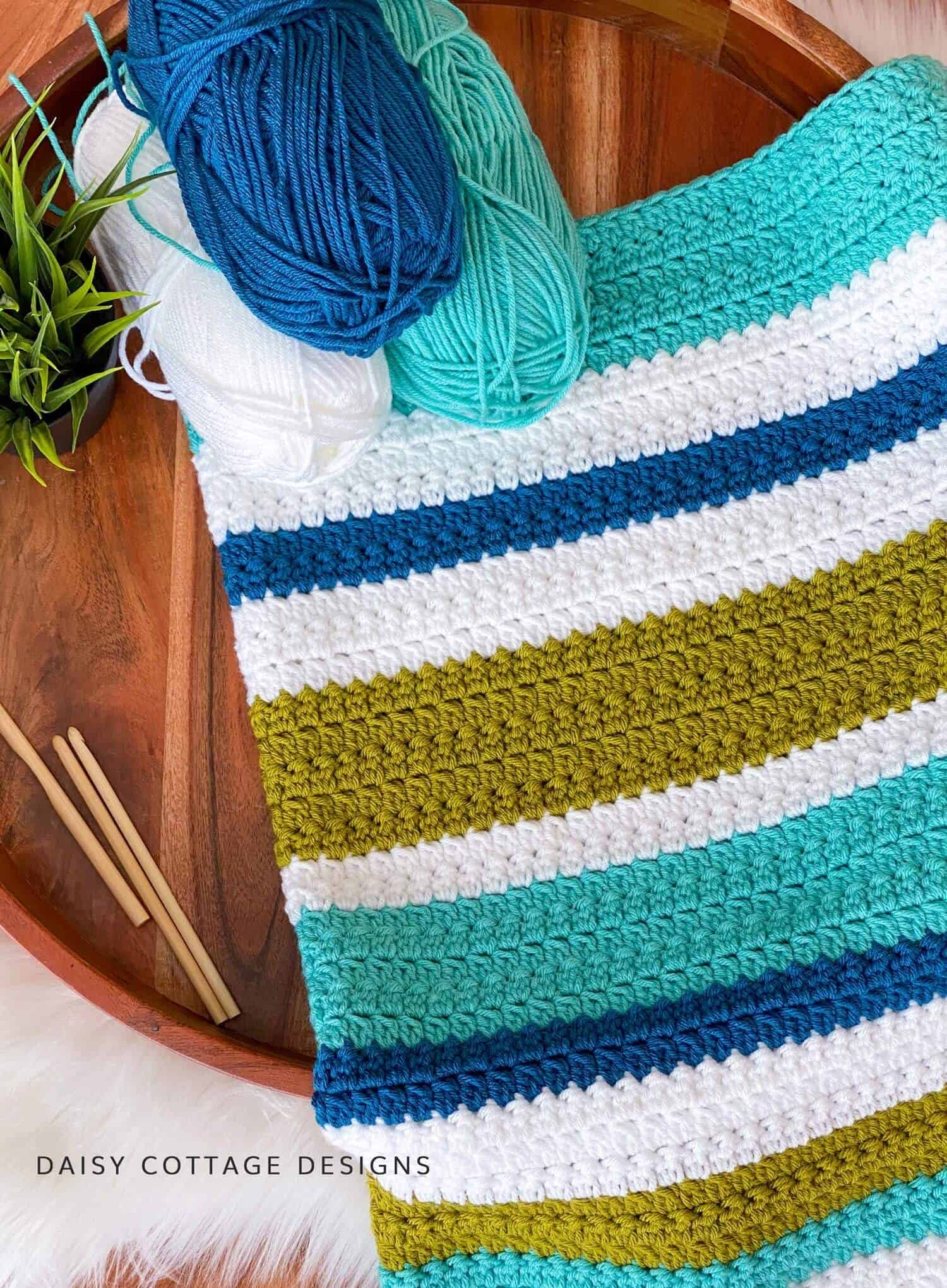 The Oceanside Throw Crochet Pattern - a textured crochet stitch blanket - is one you're going to love making! It's a free pattern on the Daisy Cottage Designs blog.