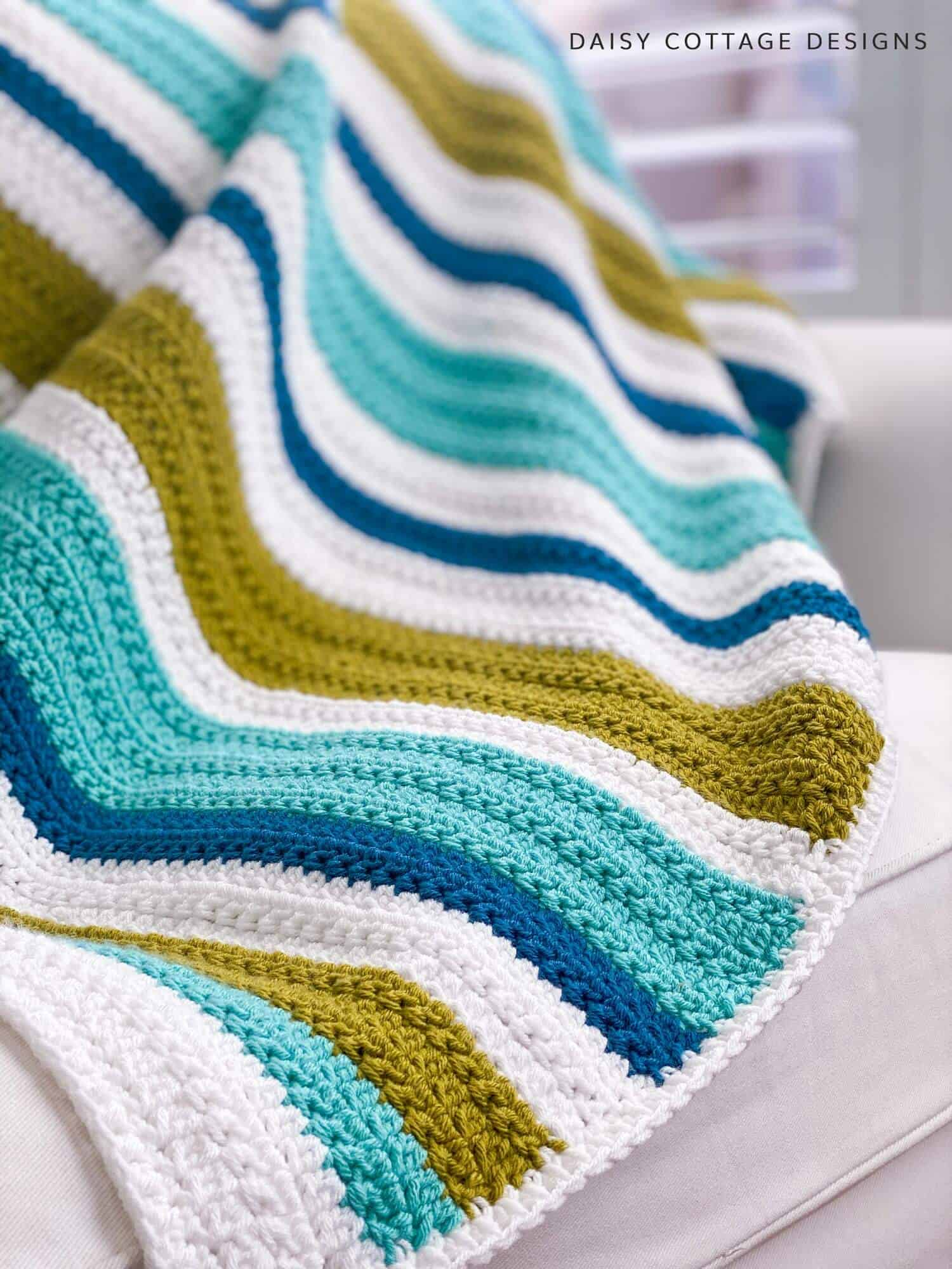 This blanket pattern features a beautiful, textured crochet stitch that's easy to make and yields stunning results.